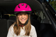 Smiling young girl portrait wearing helmet.