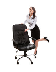 Sexy assistant inviting to relax on a office chair