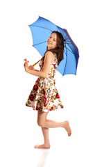 Happy young woman standing with a blue umbrella
