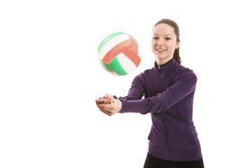 Smiling young woman playing volleyball