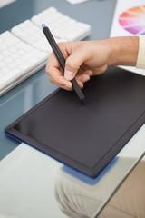 Designer working at desk using digitizer
