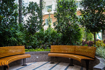 Curved Wood Benches in Garden