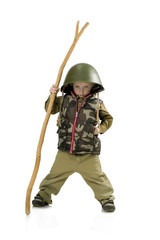 The little boy  in a helmet and uniform of a soldier