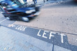 Lokk left sign on a London street with taxi cab fast approaching - 73406181