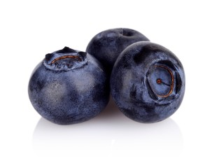 Closeup view of three blueberries isolated on white