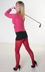 Attractive mid age female golfer wearing high heels