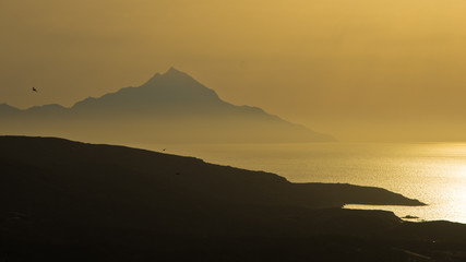 Greek coast landscape near holy mountain Athos at sunrise