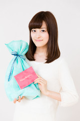 young asian woman with gift on white background