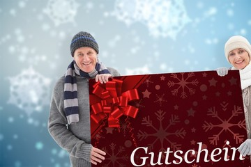 Composite image of winter couple showing poster