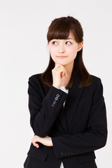 asian businesswoman thinking on white background