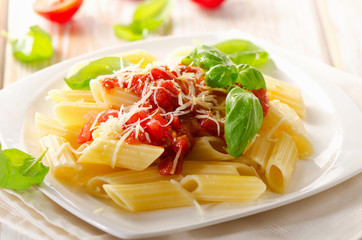 Penne pasta with   bolognese  sauce on  white wooden  table