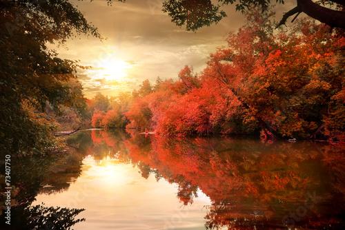 Autumn sunset over river © Givaga