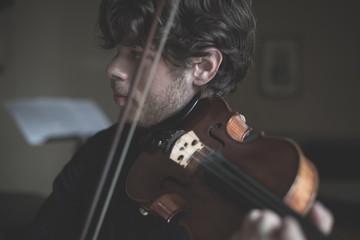 young handsome blonde violinist