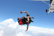 Two skydivers jump from an airplane - 73408746