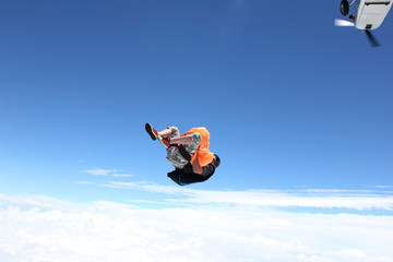 Skydiver jumps from airplane