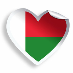 Heart sticker with flag of Madagascar isolated on white