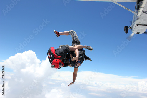 Fototapeta Two skydivers jump from an airplane
