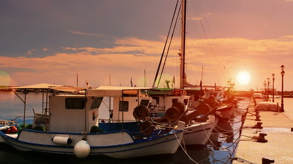 Fishing boats at the sunset