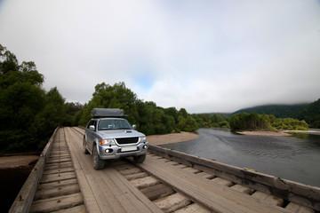 4x4 car on wooden bridge