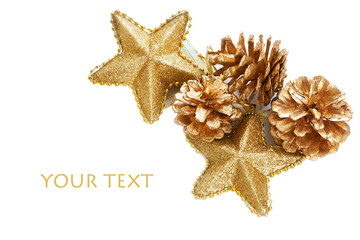 Gold plated pine cones and stars macro isolated