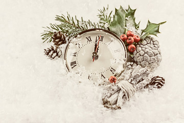 Vintage photo of Christmas clock with winter decoration