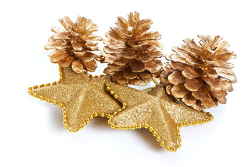 Golden pine cones and stars macro isolated