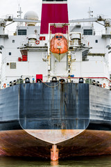 Stern of a container ship with orange life raft