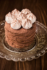 layer cake with cocoa and meringue close-up