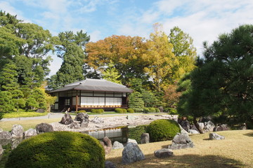 Traditional Japanese pavilion in autumn garden
