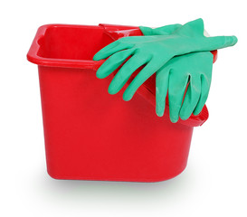 Red plastic bucket and green rubber glove