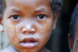 Crying girl with tear on cheek - poor african child