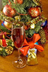 glass of wine on Christmas tree background