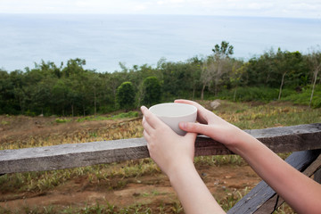 A cup of tea or coffee  in the hands