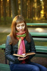 Beautiful young girl with a book
