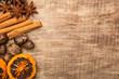 canvas print picture - Weihnachtliche Dekoration mit Zimt, Anis, Orangen und Nüssen