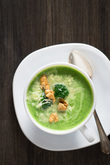 Broccoli cream soup with walnuts and parmesan