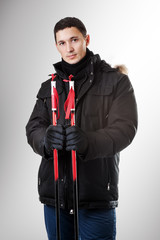 man skier wearing black fur hood winter jacket