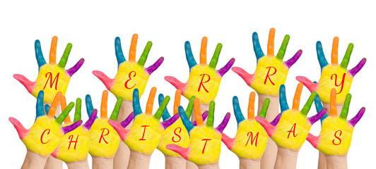 """Kids hands forming """"Merry Christmas"""""""