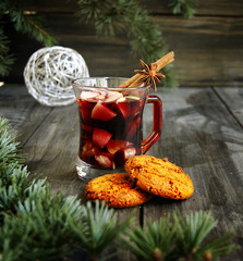 cup of hot Christmas mulled wine with cake