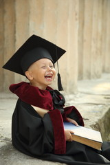 funny little boy graduate of the University
