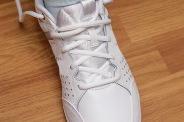 Sporting white sneakers with laces