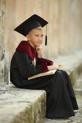 funny little boy graduate of the University