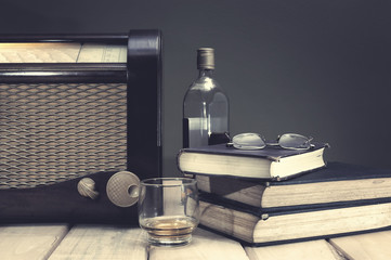 Composition with vintage radio and other items on table