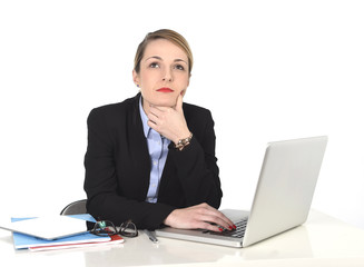businesswoman thinking and looking distraught while working