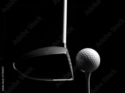 Golf Wood with a Golf Ball and Golf Tee Isolated on Black - 73416927