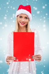 Woman with santa hat, holding a red paper without subtitles
