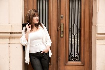 Mature woman waiting at the door...