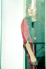 Mature woman looking out the window...