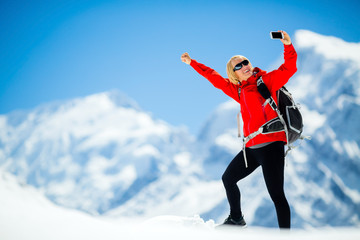 Woman success selfie on mountain peak