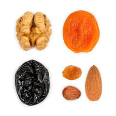 Collection of dried fruits: walnuts, dried apricots, prunes, rai